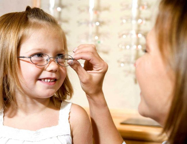 Girl getting glasses fitted