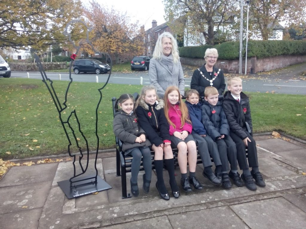 CWaC Cllr Louise Gittins, Neston Town Council Mayor Pat Kynaston, and children from Woodfall Primary School