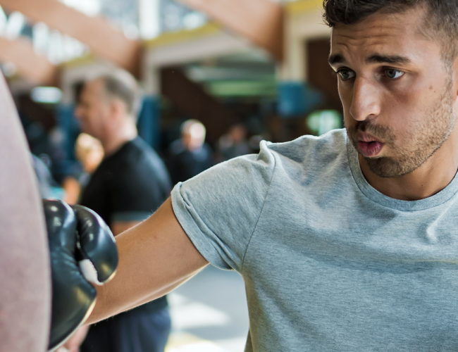 Man boxing at Total Fitness gym